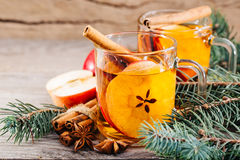 Hot apple cider with cinnamon, anise and orange Royalty Free Stock Image