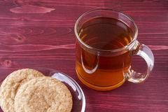 Hot Apple Cider. And snicker doodle cookies on a red wooden background Stock Photo