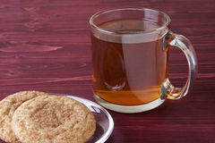 Hot Apple Cider. And snicker doodle cookies on a red wooden background Stock Photos