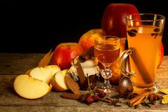Hot apple drink. Traditional drink for winter evenings. Hot apple drink. Traditional drink for winter evenings Royalty Free Stock Photos