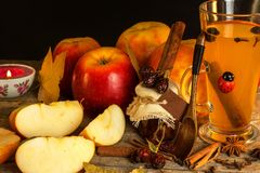 Hot apple drink. Traditional drink for winter evenings. Hot apple drink. Traditional drink for winter evenings Stock Images