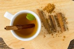 Hot apple juice in cup with cinnamon Stock Images