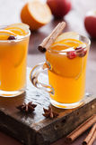 Hot apple orange cider with cinnamon spice warming drink Royalty Free Stock Image