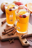 Hot apple orange cider with cinnamon spice warming drink Stock Images
