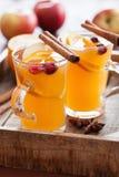 Hot apple orange cider with cinnamon spice warming drink Stock Photo