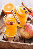 Hot apple orange cider with cinnamon spice warming drink Royalty Free Stock Photo