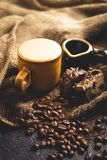 Hot Arabica coffee in brown glass and coffee beans on sack. And blackbord Stock Photo