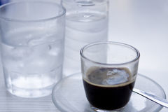 Hot aromatic espresso cup and cold water in glass Stock Images