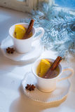 Hot and aromatic tea with orange for Christmas Stock Image