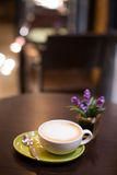 Hot art Latte Coffee in a cup and laptop on wooden table. Stock Images