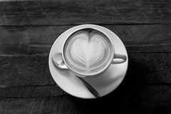 Hot art Latte Coffee in a cup on wooden table black and white to Stock Photography