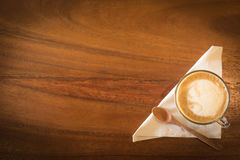 Hot art Latte Coffee in a cup on wooden table and Coffee shop bl Royalty Free Stock Images
