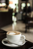 Hot art Latte Coffee in a cup on wooden table and Coffee shop bl Stock Photo