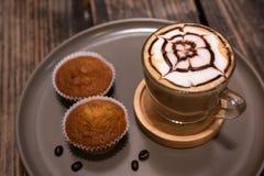 Hot art Latte Coffee and Homemade banana cake on wood background. Hot art Latte Coffee and Homemade banana cake stock image