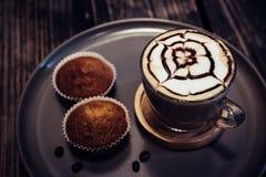 Hot art Latte Coffee and Homemade banana cake on wood background. Hot art Latte Coffee and Homemade banana cake stock photo