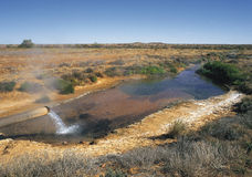 Hot Artesian bore. Hot water pouring from Arterian Bore on the Birdsville track. South Australia royalty free stock photo