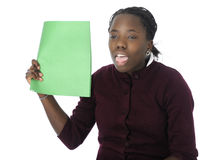 Hot!. An attractive tween girl waving a sheet of green paper to hellp her cool off.  On a white background Royalty Free Stock Photo