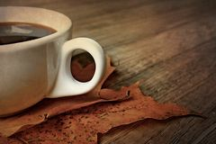 Hot autumn black espresso coffee on a wooden table and autumn m Royalty Free Stock Images