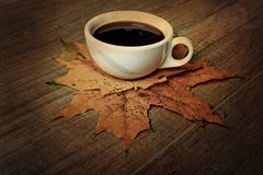 Hot autumn black espresso coffee on a wooden table and autumn m Stock Image