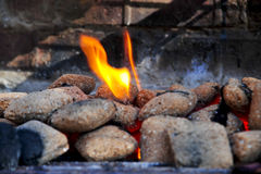 Hot Barbecue coals on fire. Close up details of hot barbecue coals on fire Royalty Free Stock Image