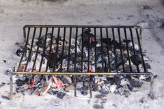 Hot barbecue iron grill and glowing charcoal Royalty Free Stock Photos