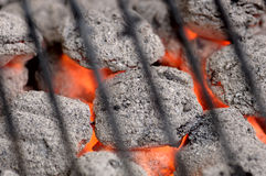 Hot Barbeque Charcoal. Hot barbeque briquets beneath a grill. You can see the radient heatwaves! 12MP camera Royalty Free Stock Image