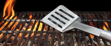 Hot BBQ Grill Tools In The Flame Stock Image