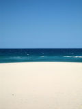 Hot Beach. Hot day at the beach. The sky is clear blue. The sand is golden white Royalty Free Stock Photography