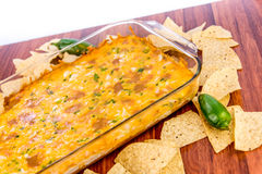 Hot bean dip with jalapenos, sour cream and melted cheddar chees Stock Photography