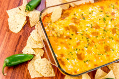 Hot bean dip with jalapenos, sour cream and melted cheddar chees Royalty Free Stock Images