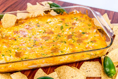 Hot bean dip with jalapenos, sour cream and melted cheddar chees Royalty Free Stock Photography