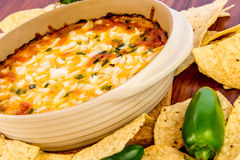 Hot bean dip with jalapenos, sour cream and melted cheddar chees Stock Images