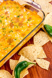 Hot bean dip with jalapenos, sour cream and melted cheddar chees Stock Photos