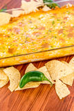 Hot bean dip with jalapenos, sour cream and melted cheddar chees Stock Image