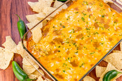 Hot bean dip with jalapenos, sour cream and melted cheddar chees. Hot layered bean dip with jalapenos, sour cream and melted cheddar cheese Royalty Free Stock Photo