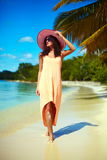 Hot beautiful woman in colorful sunhat on beach Stock Images