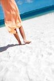 Hot beautiful woman in dress walking near beach ocean on hot summer day Stock Photo