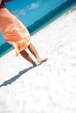 Hot beautiful woman in dress walking near beach Royalty Free Stock Photos