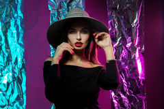 Hot beautiful woman in hat with wide brim Royalty Free Stock Images