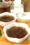 Hot Beef Consomme. On light background Royalty Free Stock Photos