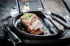 Hot beef with fresh herbs ready to eat. On burnt table Stock Images
