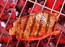 Hot beefsteak. Hot beefsteak on barbecue. Close stock photos