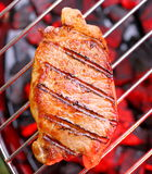 Hot beefsteak. Hot beefsteak on barbecue. Tasty piece of meat with crust royalty free stock image