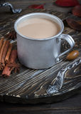Hot beverage in big metal mug and spices. Stock Photography