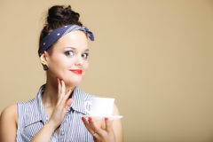 Hot beverage. Retro woman holding tea or coffee cup Royalty Free Stock Photos
