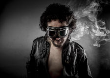 Hot, biker with sunglasses era dressed Leather jacket, huge smok Royalty Free Stock Photos