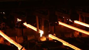 Hot billet bloom continuous casting, also called strand casting.  stock footage