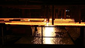 Hot billet bloom continuous casting, also called strand casting.  stock video