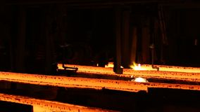 Hot billet bloom continuous casting, also called strand casting.  stock video footage