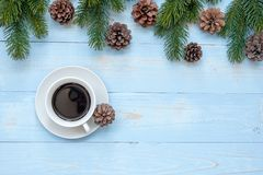 Hot black coffee cup with Christmas decoration, Happy New Year and Xmas. Holidays royalty free stock images